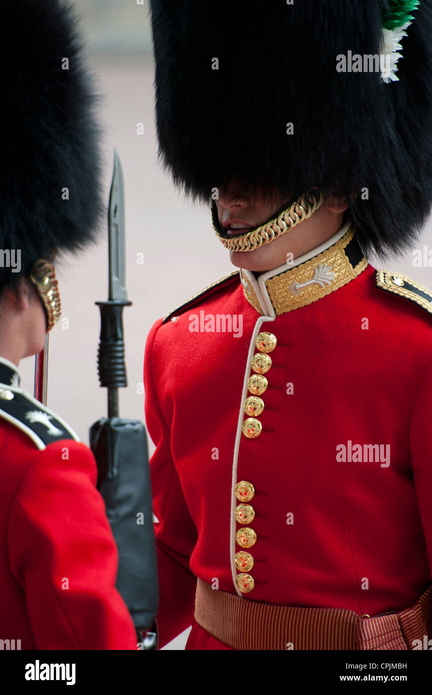 Guardsman giving orders and inspecting another soldier on the Mall in London during the Royal Wedding. - Stock Image