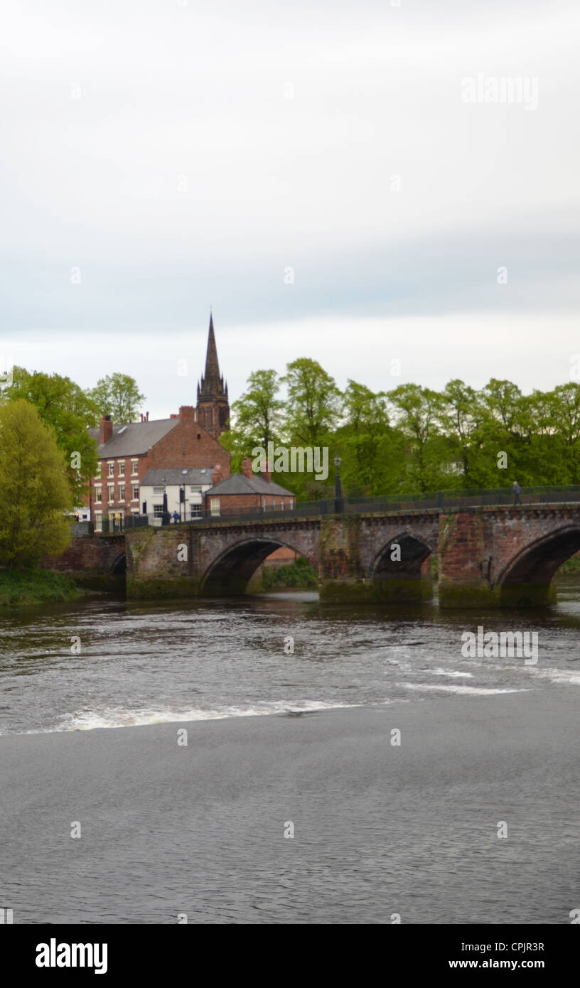 Old Dee Bridge over the river Dee with St Mary without the walls church behind, Chester Stock Photo