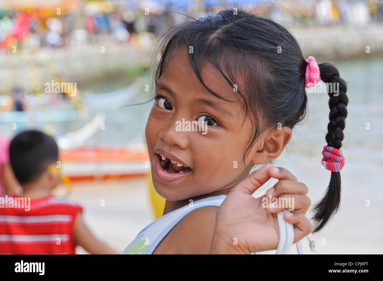 Pretty Smiling Little Asian Girl With Milk Teeth Diastema Tooth Gap Braided Ponytail Hair Sabang Puerto Galera Philippines Asia