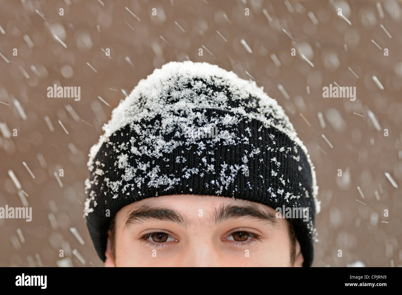 Man Outside in Snow, Close Up. - Stock Image