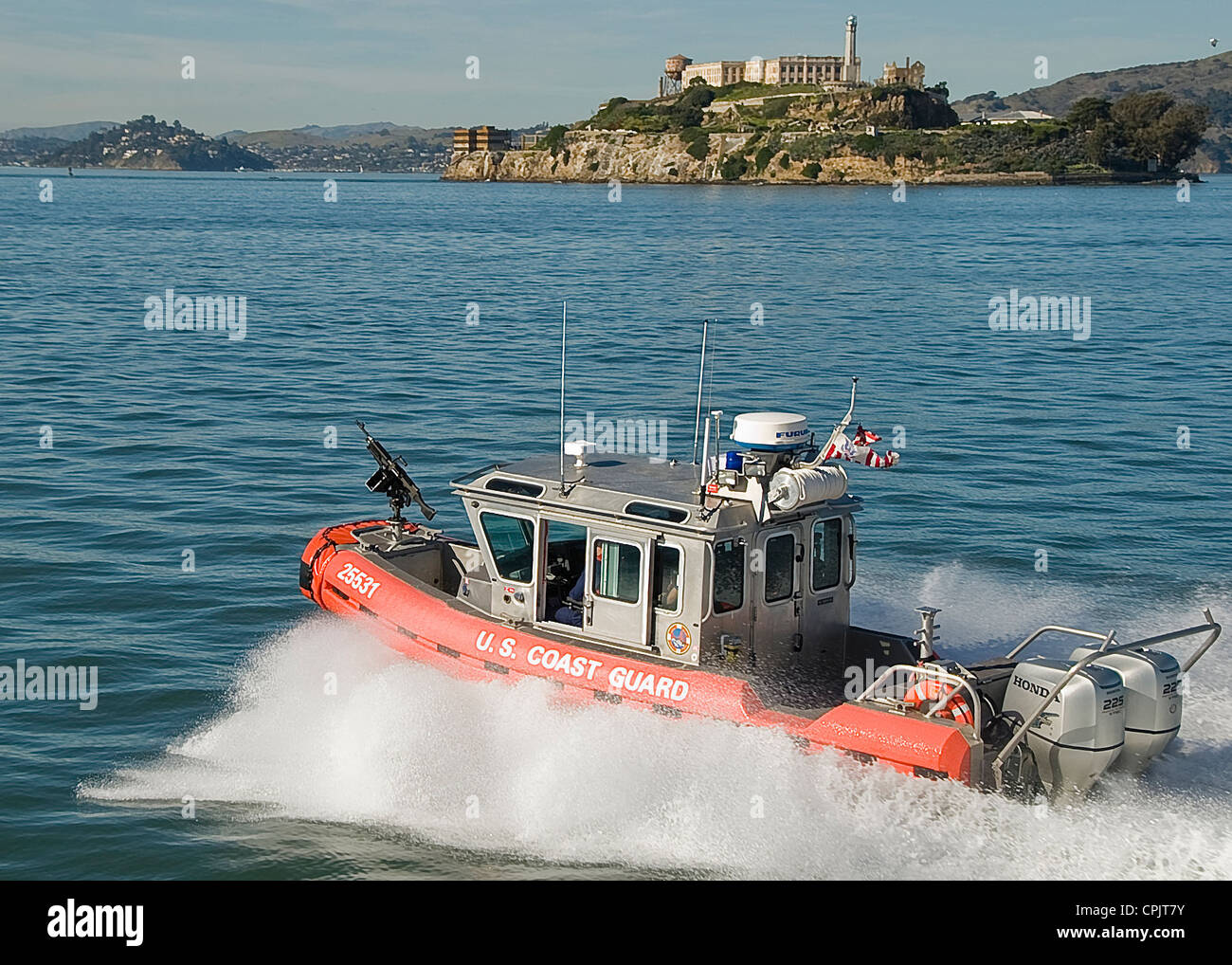 A Coast Guard 25-foot Response Boat patrols near Alcatraz Island February 10, 2011 in San Francisco Bay. - Stock Image