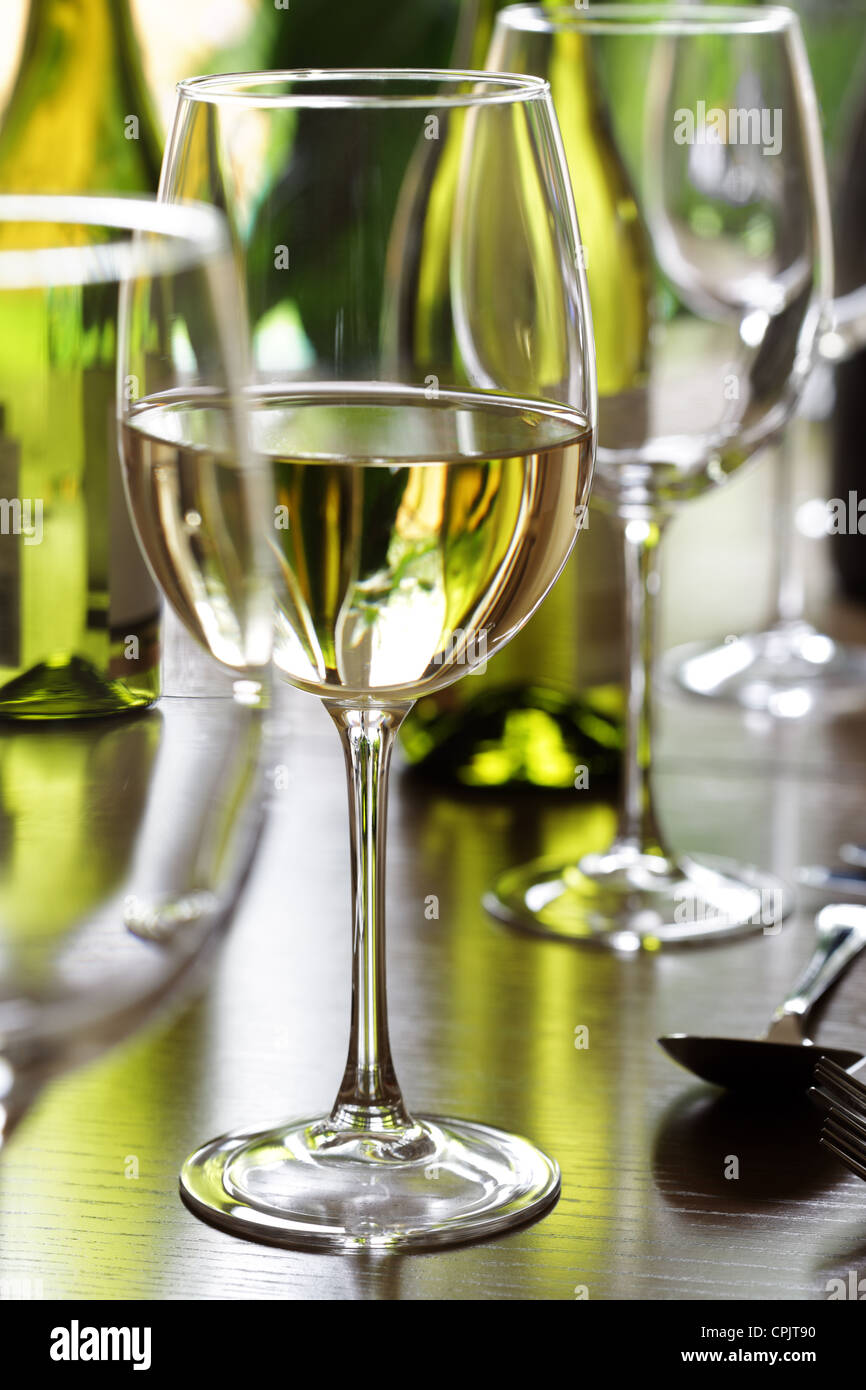 Wine glass and place settings - Stock Image
