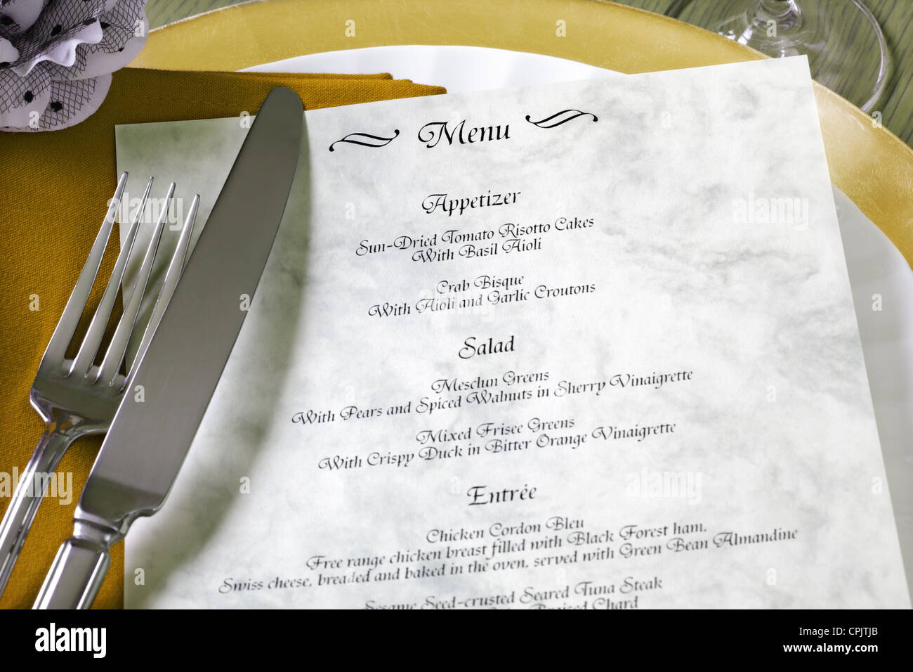 Menu and cutlery on restaurant table - Stock Image