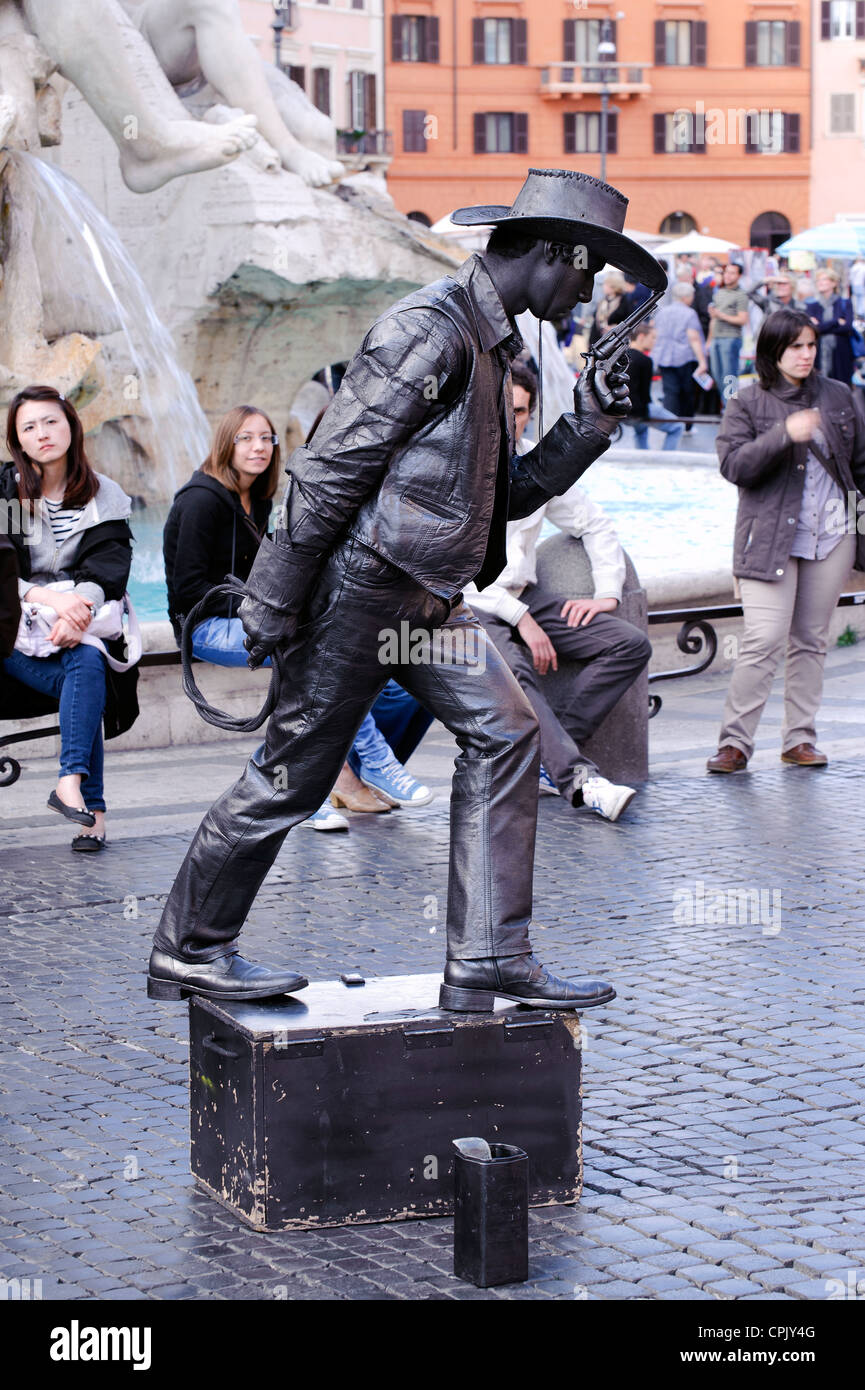 Street performer dressed as a black cowboy in Piazza Navona, Rome. - Stock Image