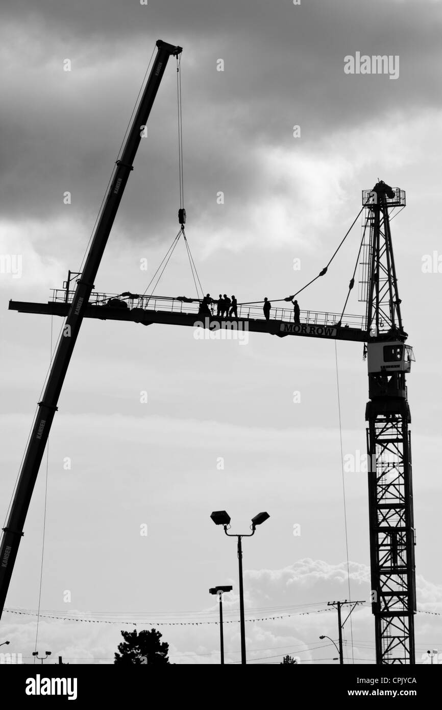 Construction workers working on large  building construction crane-Victoria, British Columbia, Canada. - Stock Image