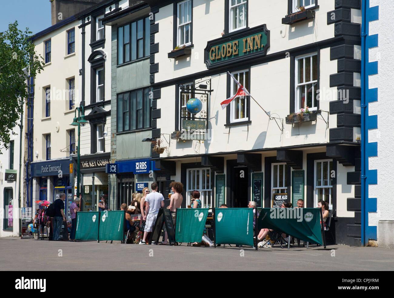 People drinking outside the Globe Inn, Market Place, Kendal, Cumbria, England UK Stock Photo