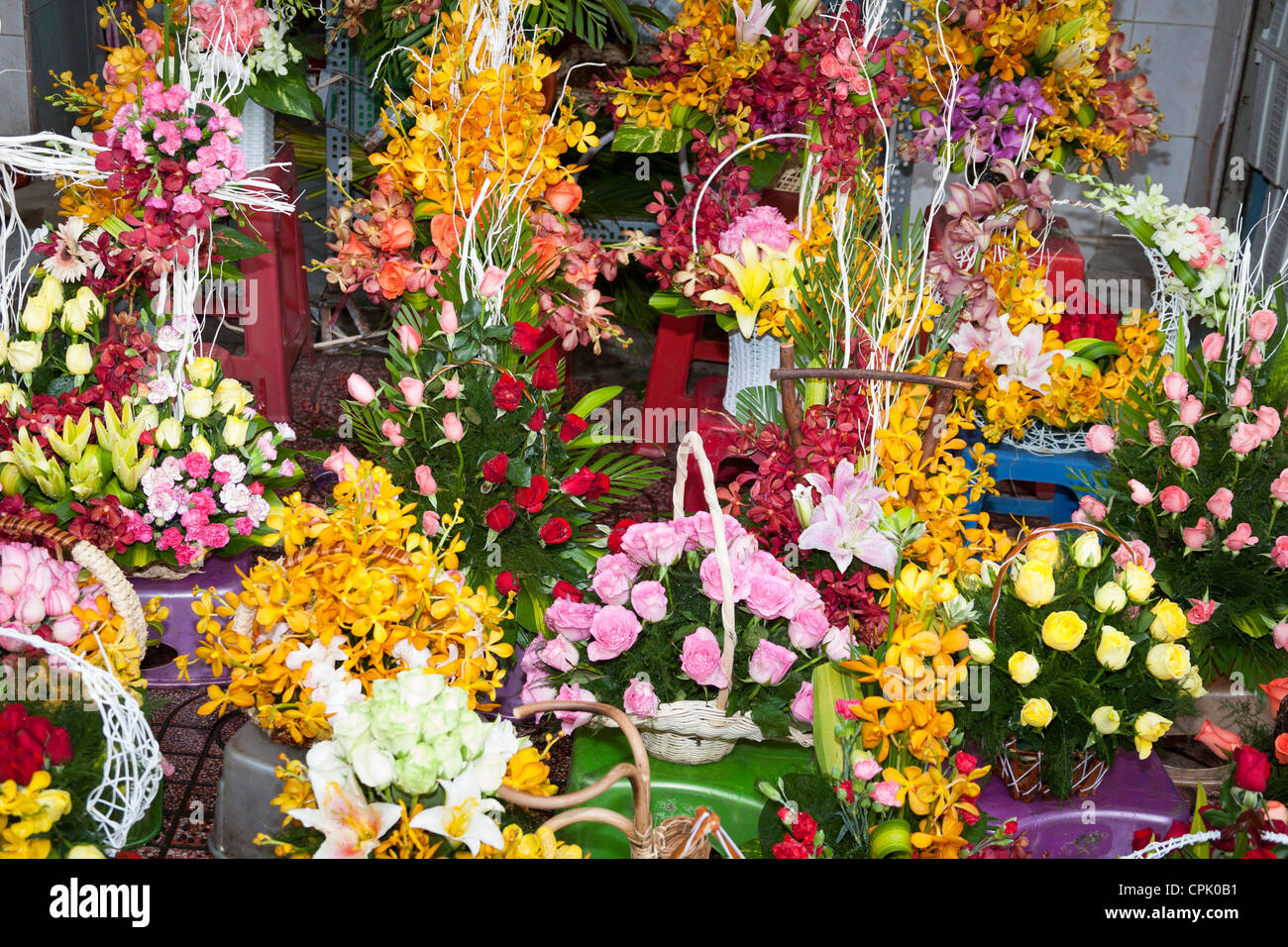 Many flowers bouquets stock photos many flowers bouquets stock colourful bouquets of flowers for sale outside ben thanh market ho chi minh city izmirmasajfo