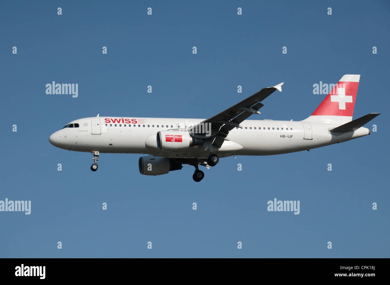 The Swiss International Air Lines Airbus A320-214 (HB-IJF) about to land at Heathrow Airport, London, UK. Feb 2012 Stock Photo