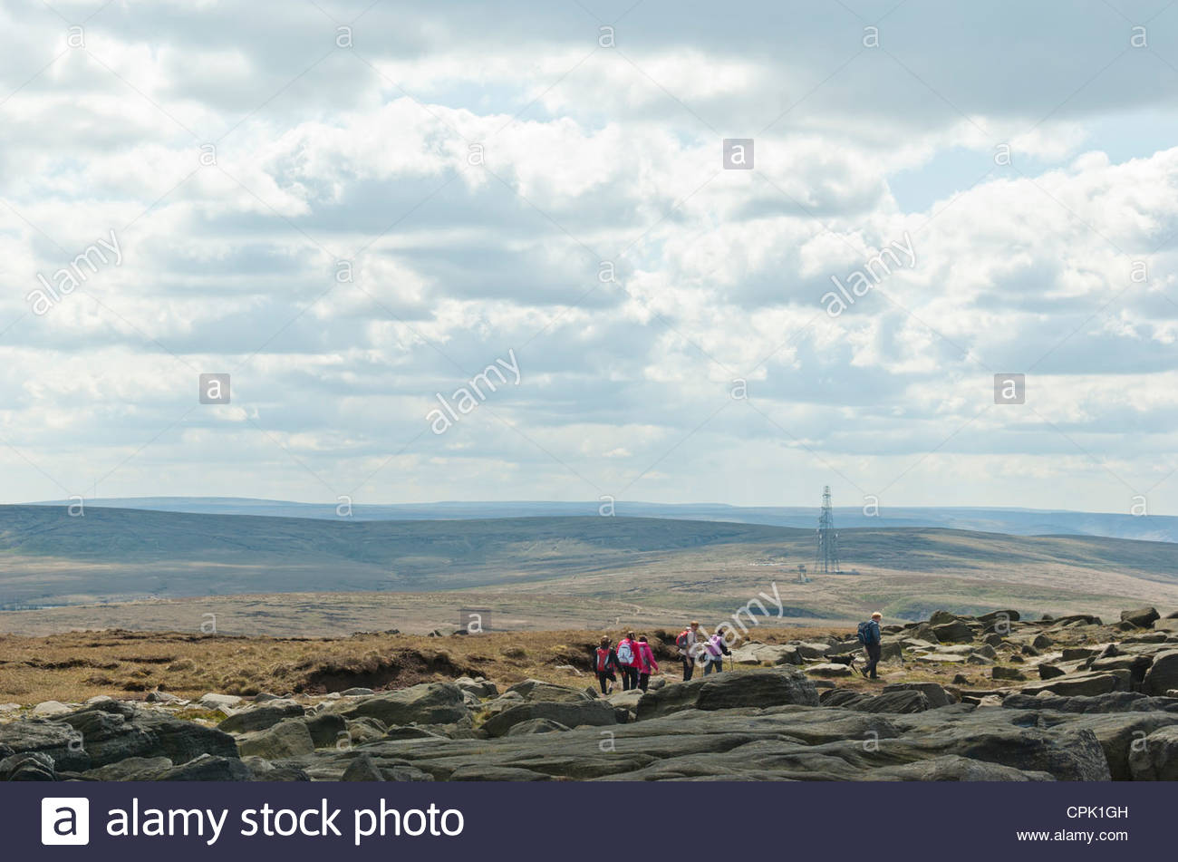 A group of hikers on the Pennine Way along the West Yorkshire / Lancashire border. (South Pennines). - Stock Image