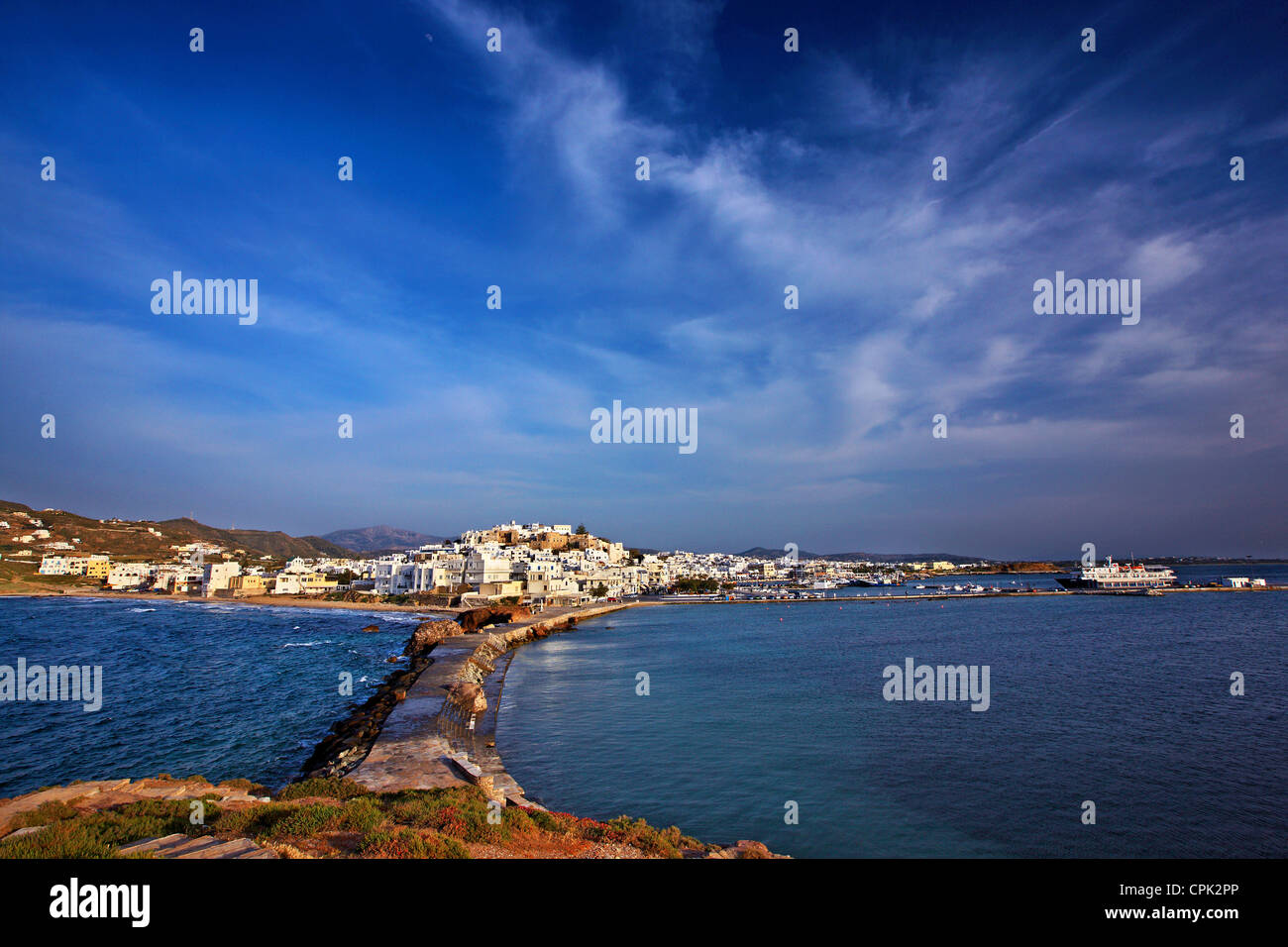 "The Chora (""capital"") of Naxos island with the castle of Sanoudos on top, as seen from the ""Portara"", Cyclades, Stock Photo"