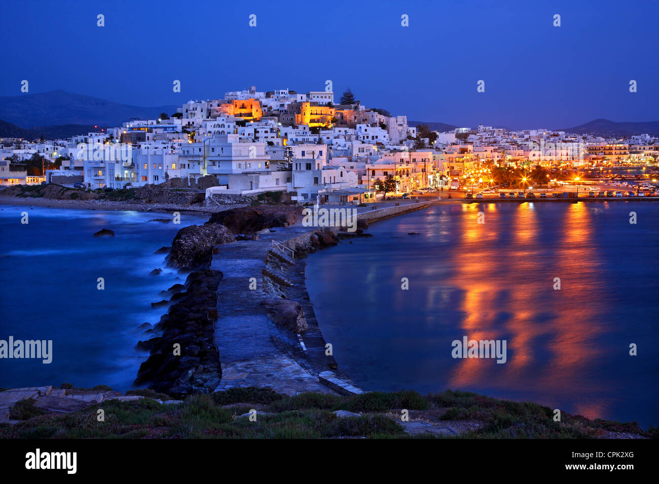 """The Chora (""""capital"""") of Naxos island with the castle of Sanoudos on top, as seen from the """"Portara"""", Cyclades, Stock Photo"""