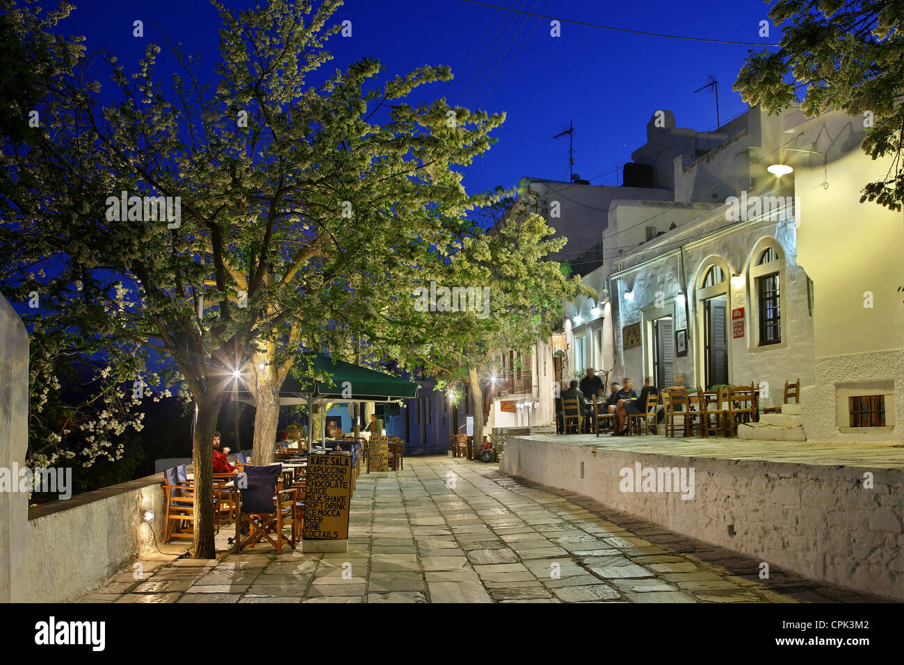 The central alley of Apiranthos village at night. Naxos island, Cyclades, Greece - Stock Image