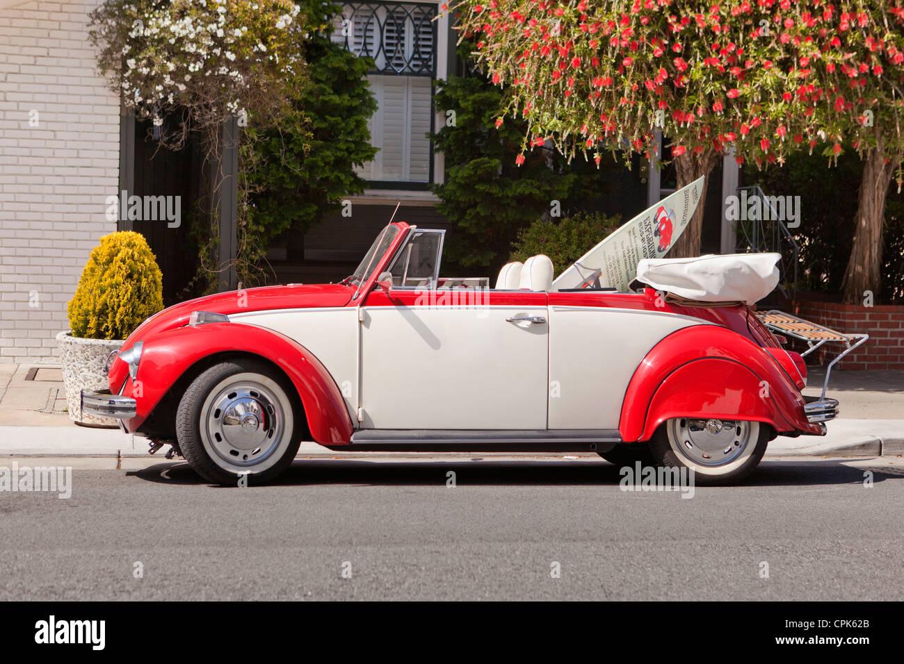 A vintage convertible Volkswagen beetle - Stock Image