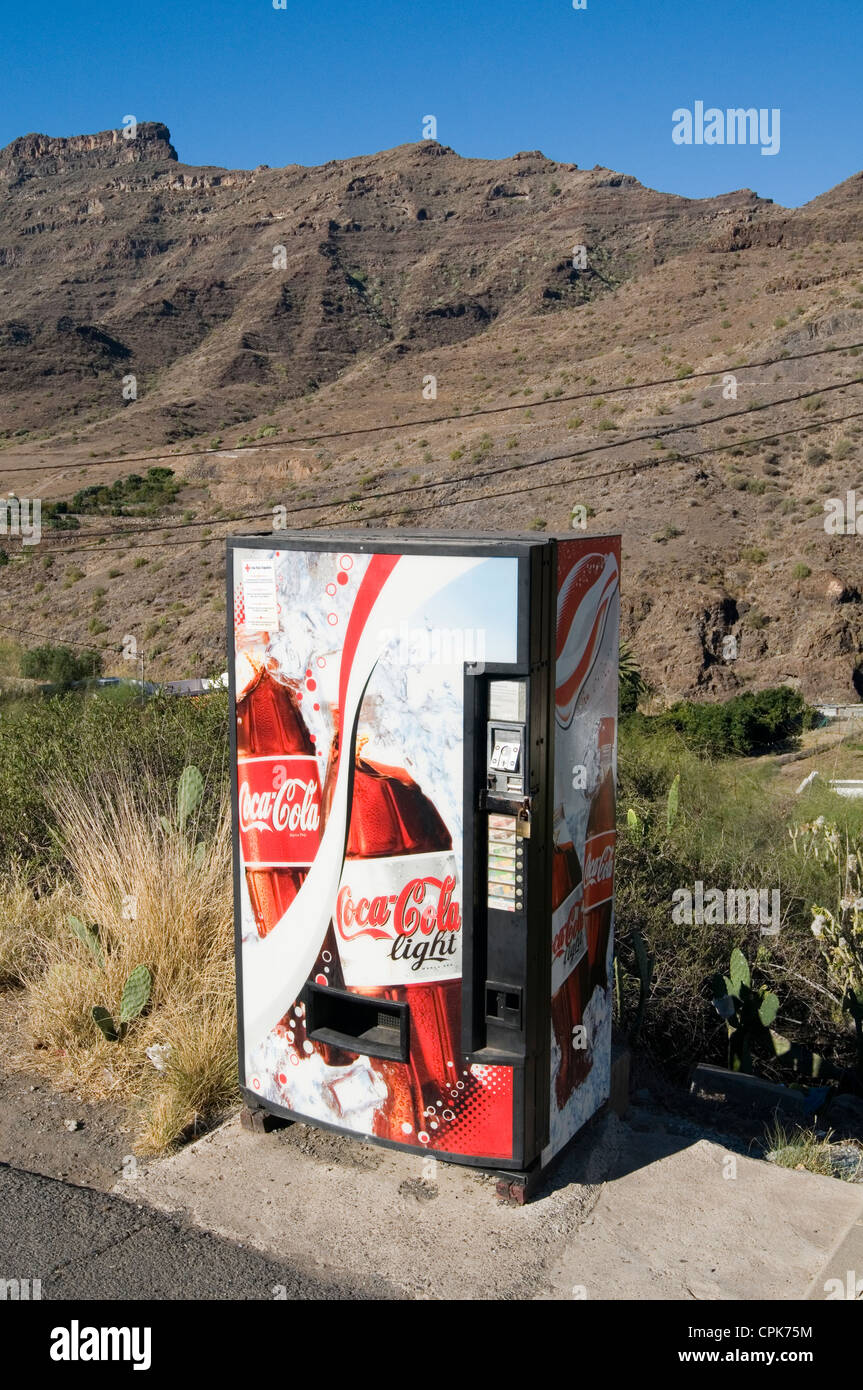 coke coca cola vending machines machines marketing chilled can cans of cold desert brand branding - Stock Image