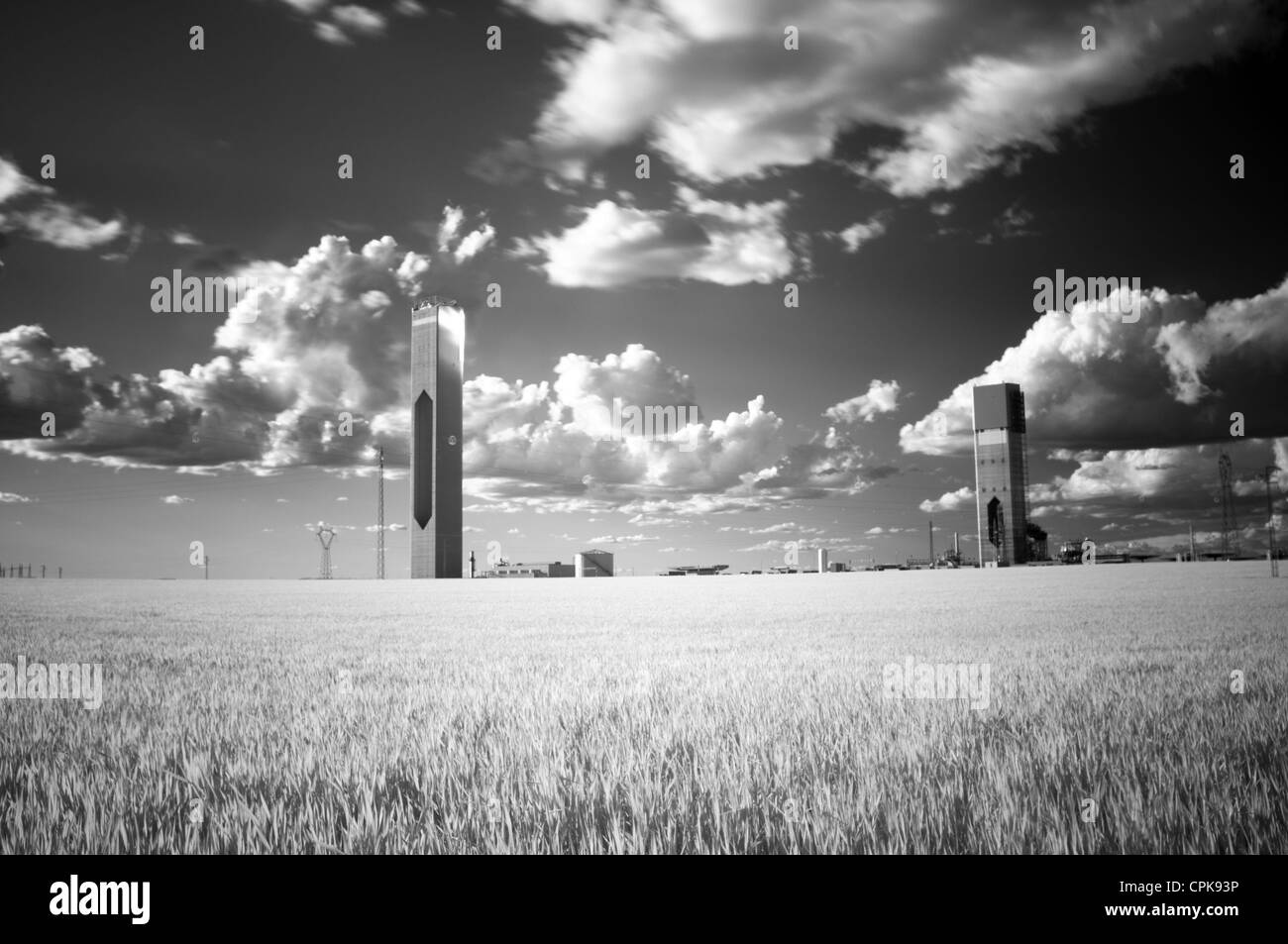 Infrared image of solar plant towers in a wheat field, Sanlucar la Mayor, Seville, Spain - Stock Image