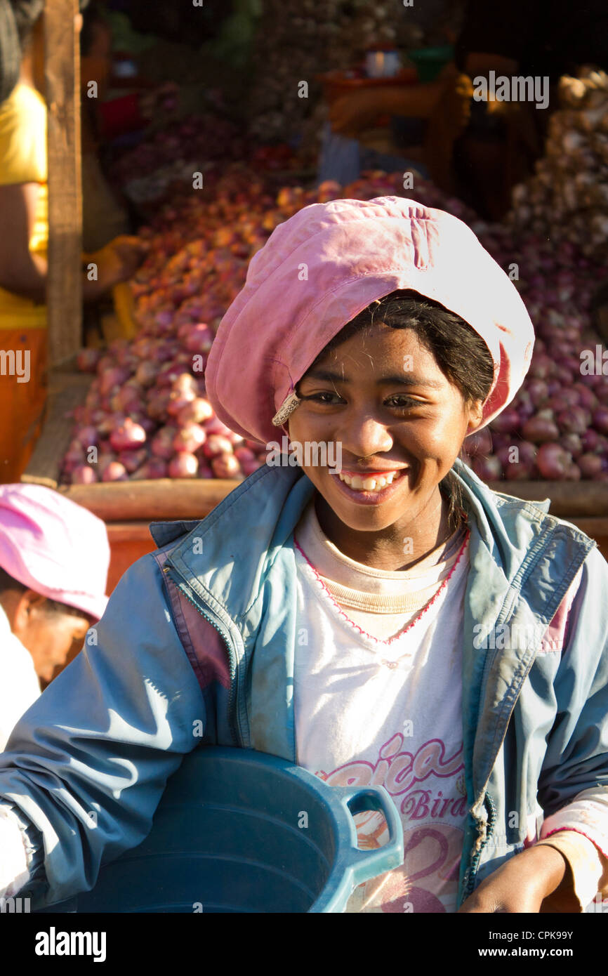 young Malagasy boy with pink cap at market, Antsirabe, Madagascar - Stock Image
