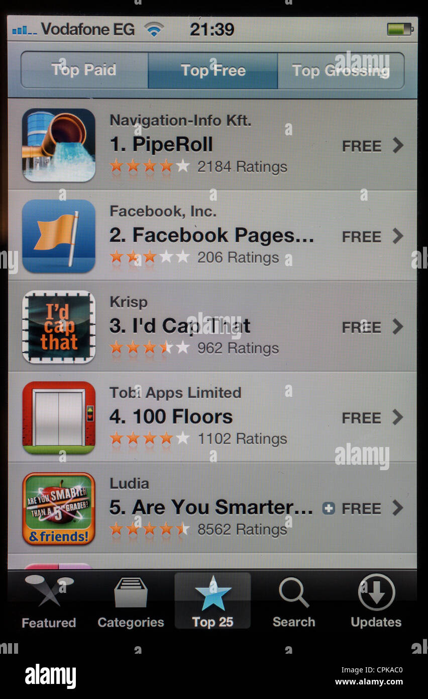 screen of Apple iPhone 4s showing favourite free apps - Stock Image