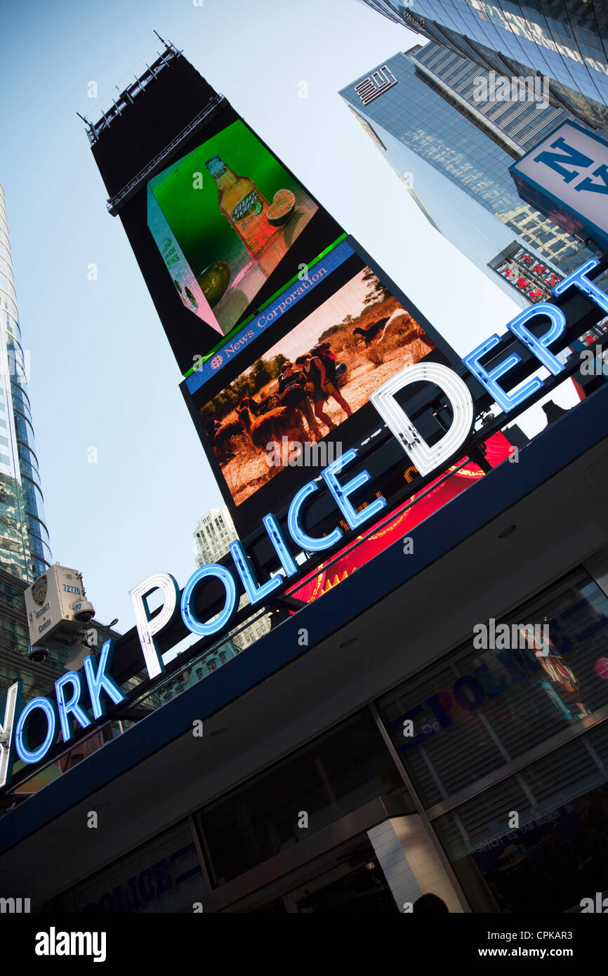 New York City, Manhattan, Times Square at dusk NYPD police dept department Times square new York,times square,times - Stock Image