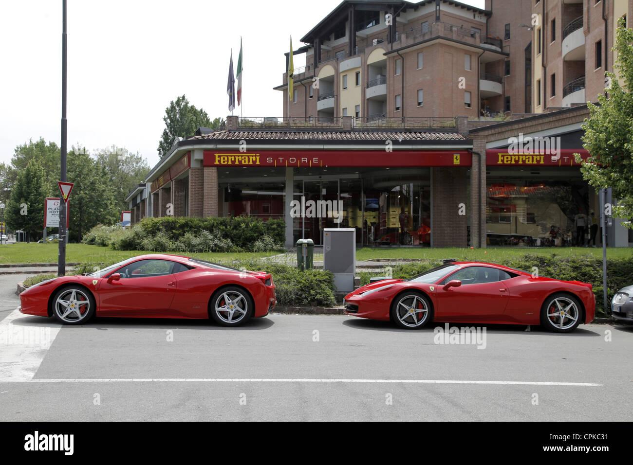 RED FERRARI 458 CARS & STORE MARANELLO ITALY 08 May 2012 - Stock Image