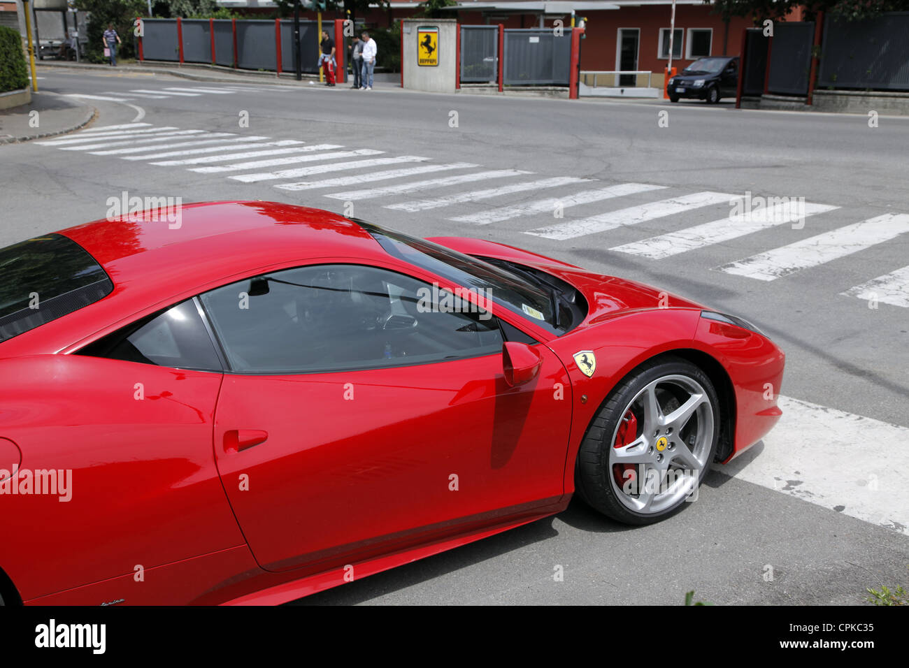 RED FERRARI 458 CAR & FACTORY GATES MARANELLO ITALY 08 May 2012 - Stock Image