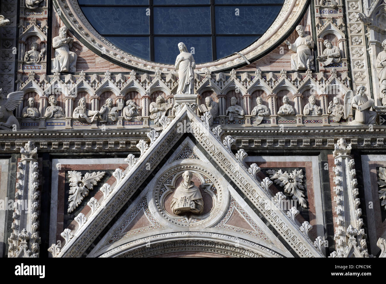 CARVINGS ON CATHEDRAL OF SIENA FACADE SIENA TUSCANY ITALY 10 May 2012 - Stock Image