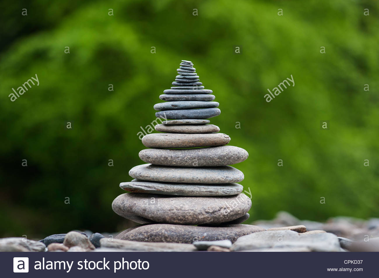 Stacked pebbles in a pyramid shape - Stock Image
