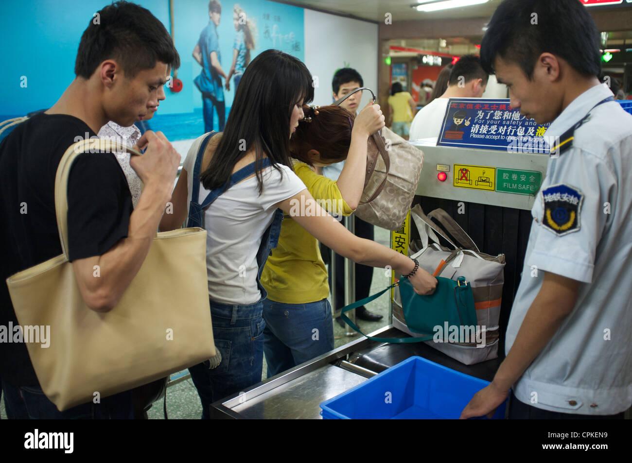 Subway security bag check in Beijing, China. 25-May-2012 - Stock Image