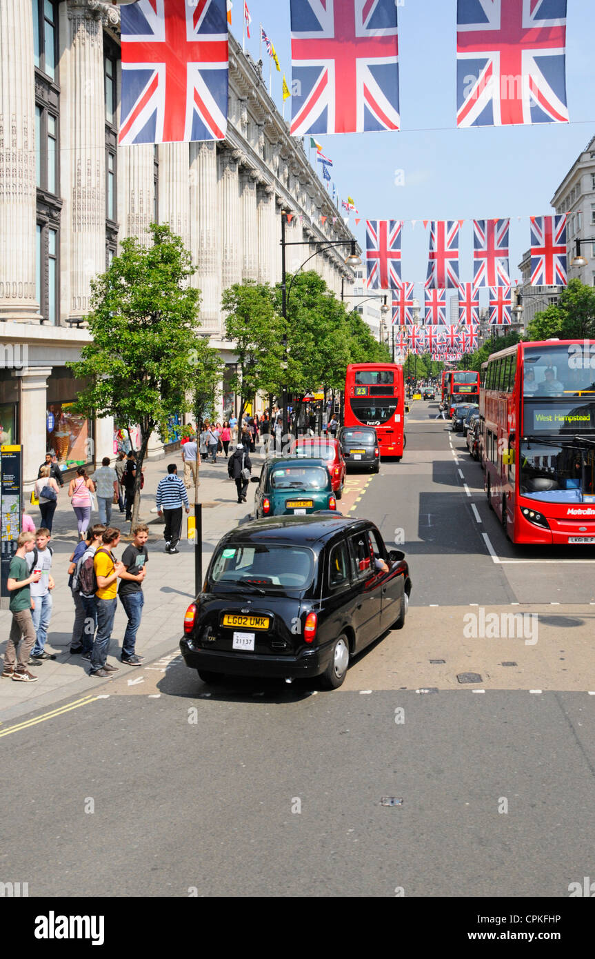 Jubilee bunting and Union Jacks in Oxford Street, may be kept in place during 2012 Olympics - Stock Image