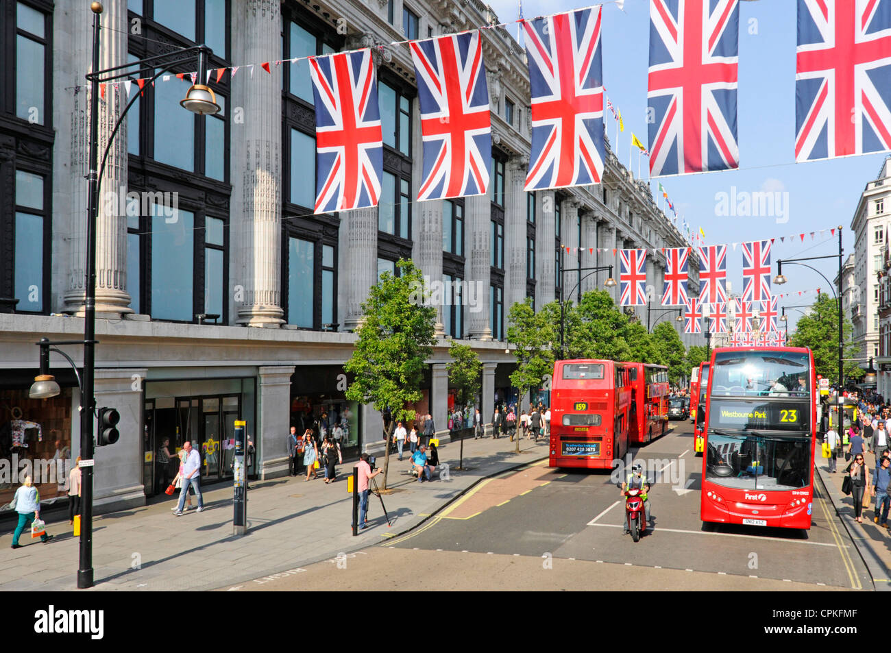 Oxford Street Union Jack Flags Queens Jubilee 2012 Olympics celebrations buses outside Selfridges shopping department store West End London England UK Stock Photo