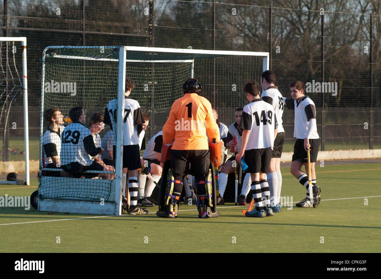Half time team talk at club hockey match, UK - Stock Image