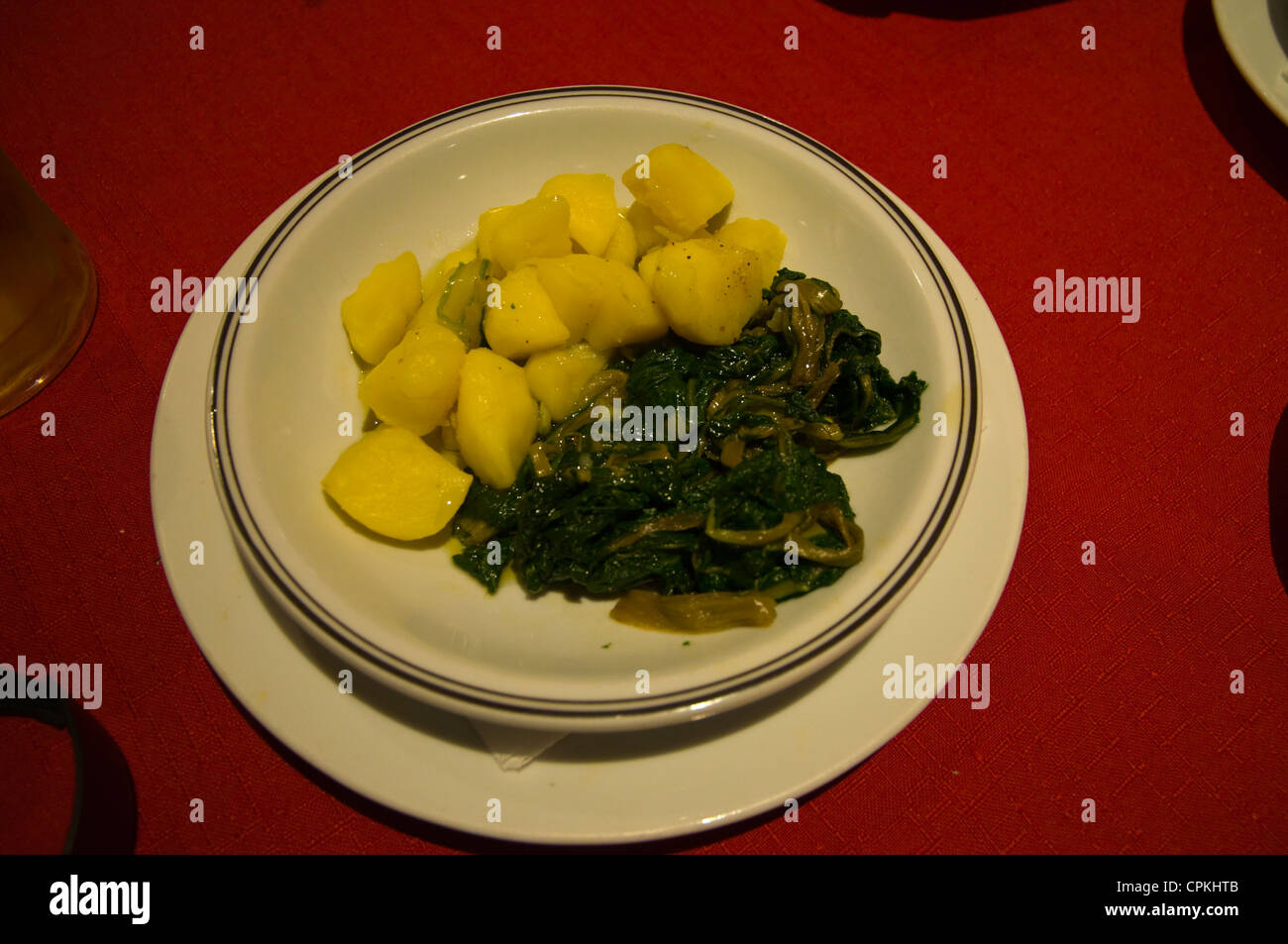 Local vegetable delicacy Swiss Chard aka silverbeet with boiled potatoes in a restaurant - Stock Image