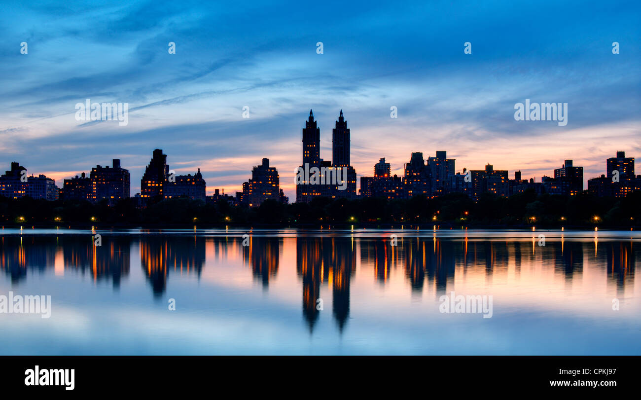 Skyline of buildings along Central Park West viewed from above Jackie Kennedy Onassis Reservoir in New York City. - Stock Image