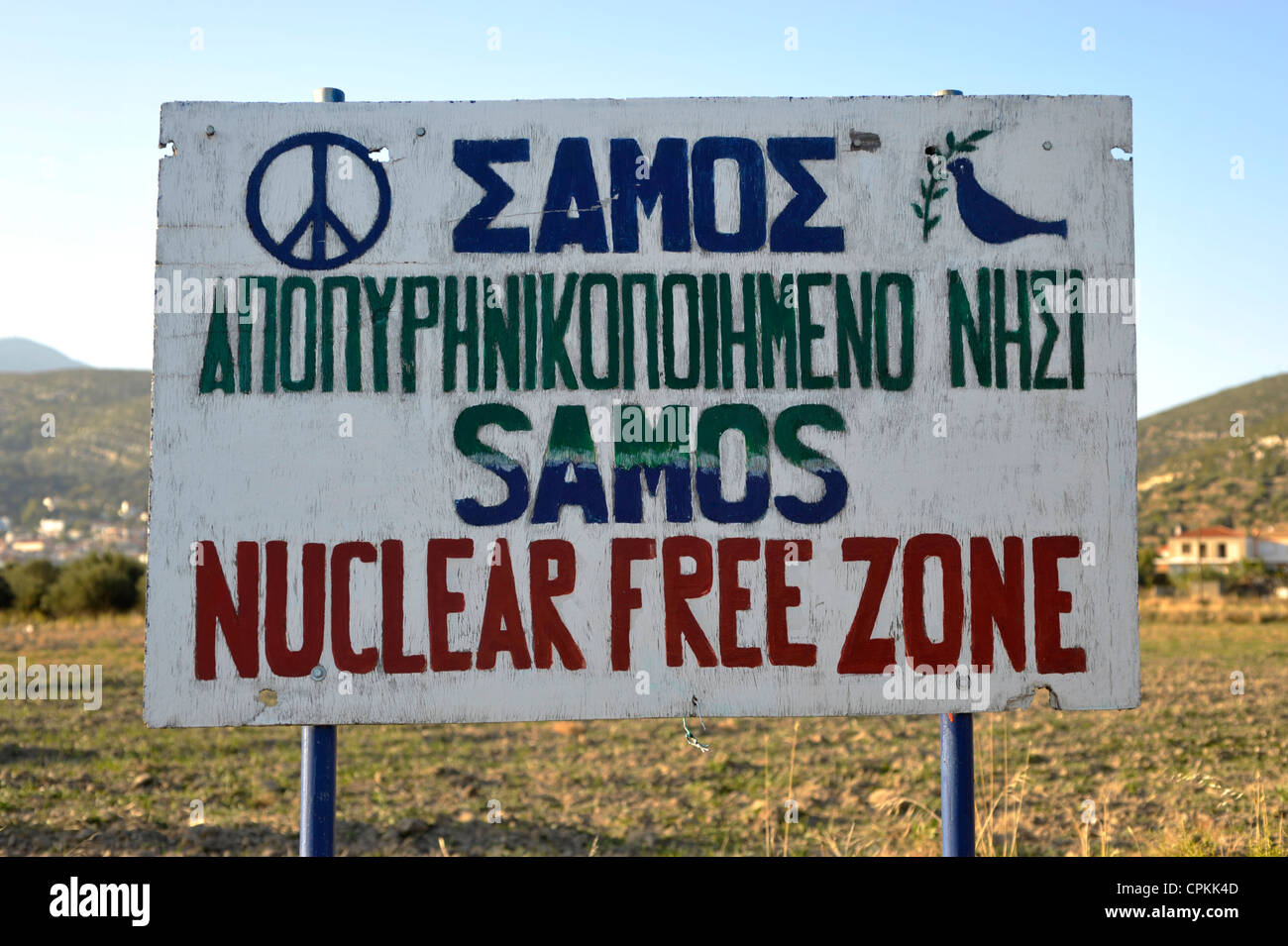 Sign with peace symbol and title: Samos Nuclear Free Zone. Samos Island, Greece 2009. - Stock Image