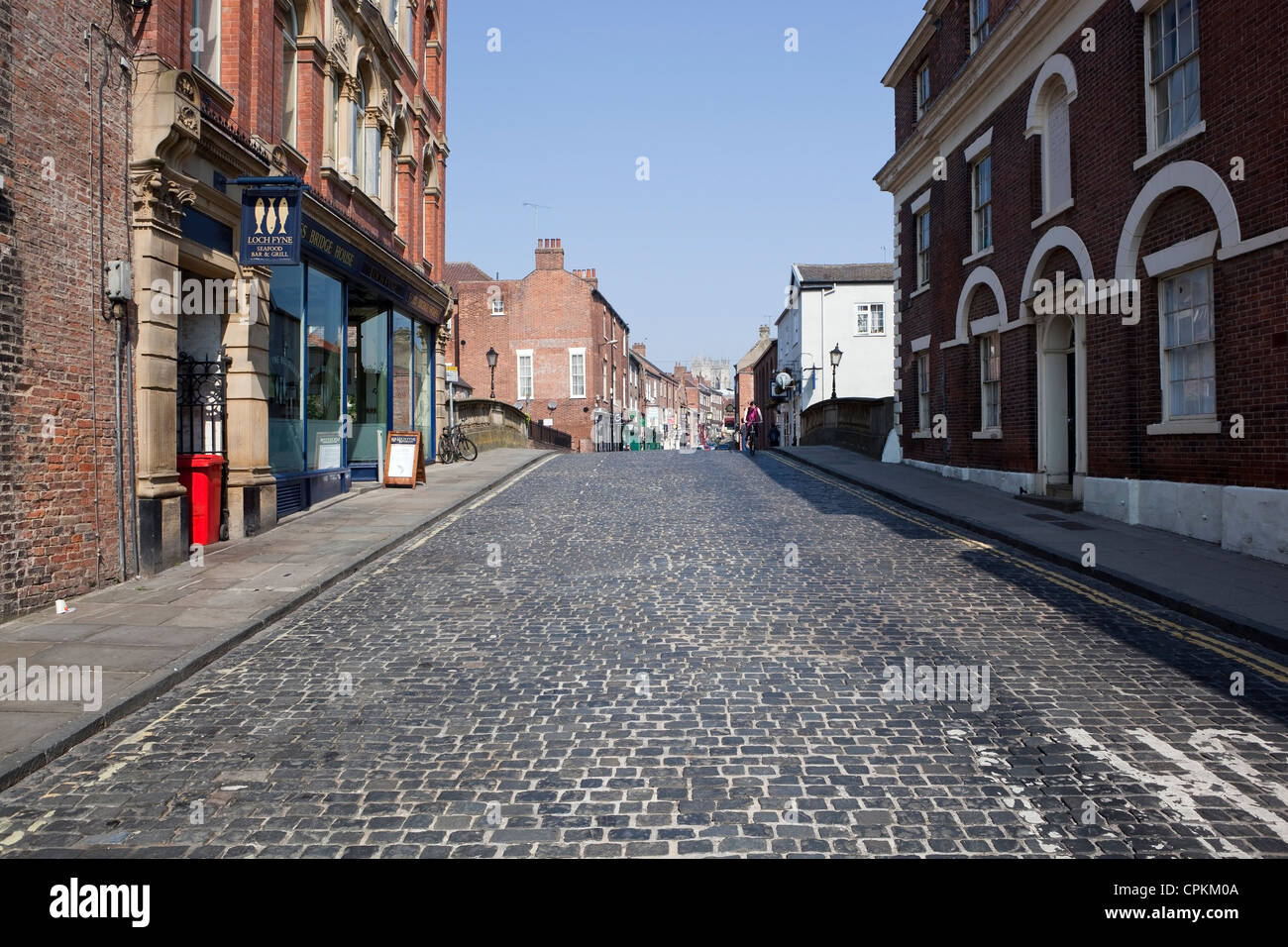 Fossgate cobbled street flanked by historic buildings in the Ancient city of York, England. - Stock Image