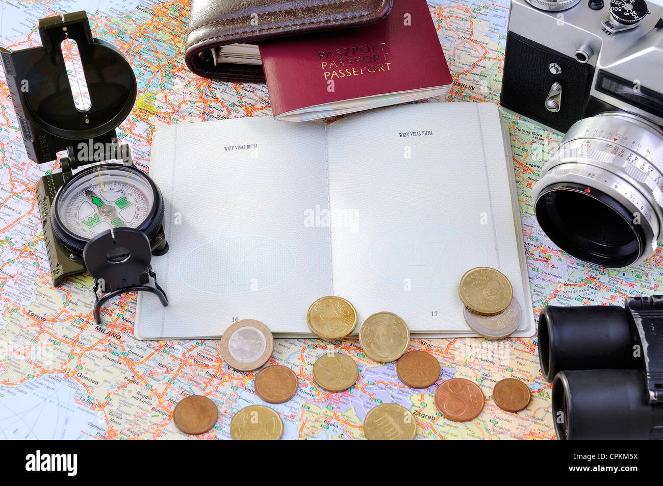 a group of travel related items on a map - Stock Image