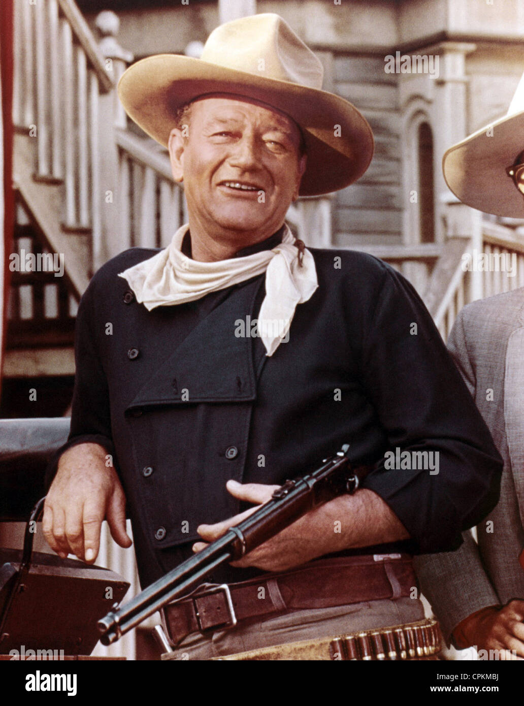 A portrait of John Wayne with shotgun in cowboy western film. - Stock Image