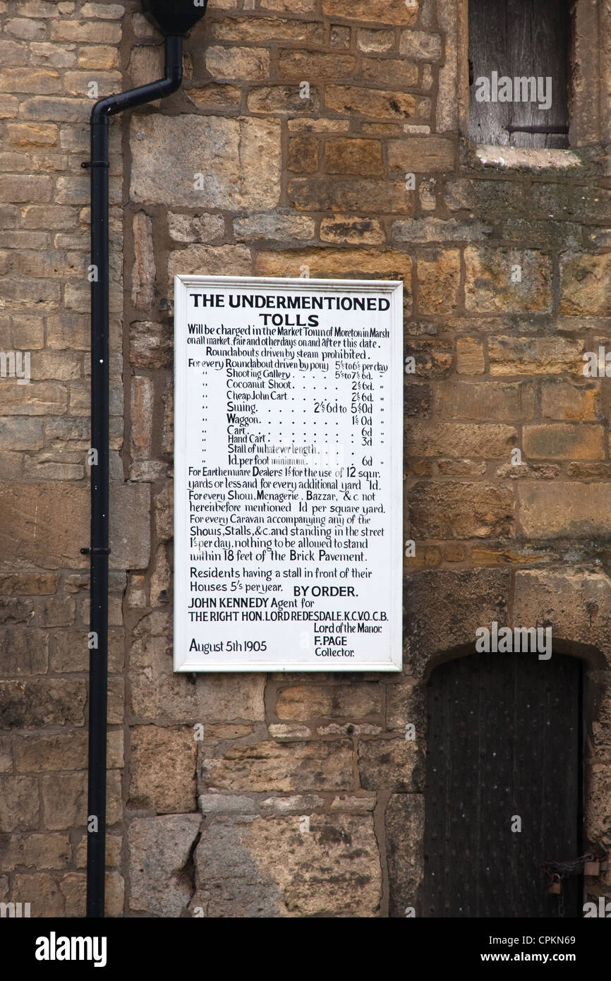 Old sign detailing Tolls for use of Market Place, Moreton-in-Marsh - Stock Image