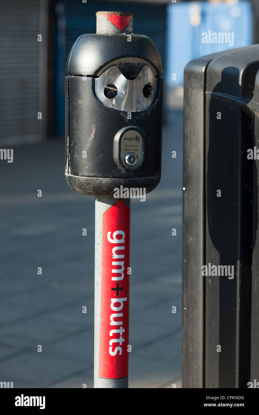 A bin for cigarette butts and gum. London. England. - Stock Image