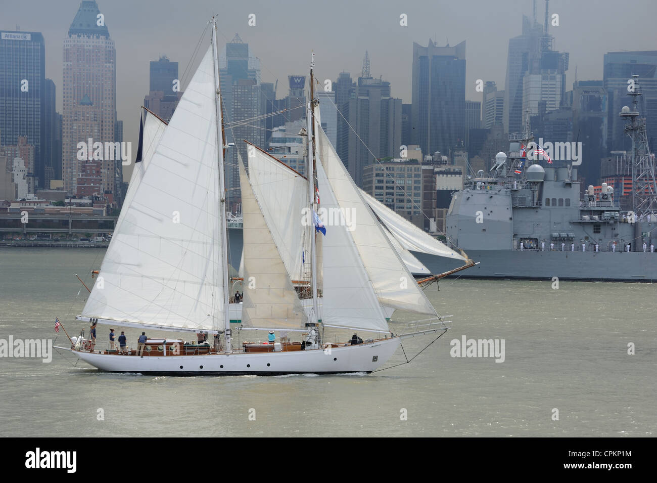 The schooner Shearwater, built in 1929 and a national landmark, and the cruiser USS San Jacinto, participated in - Stock Image