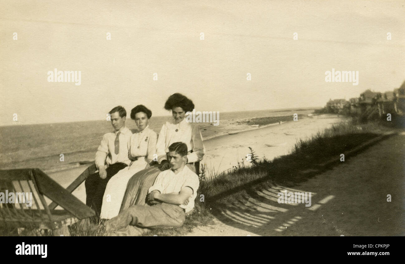 Summer 1904 photograph, two couples in front of the beach homes in Ocean Bluff-Brant Rock, Massachusetts. - Stock Image