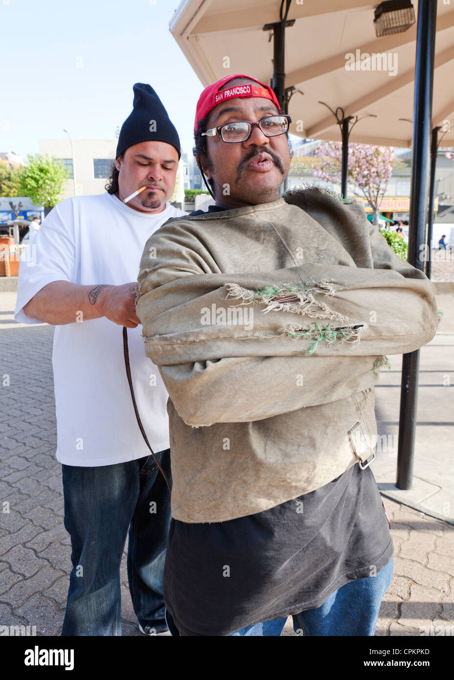 A street escape artist getting tied up - San Francisco, California USA - Stock Image