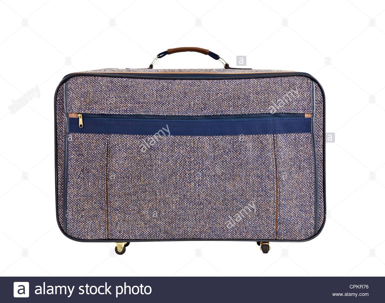 Old tweed suitcase isolated on white. - Stock Image