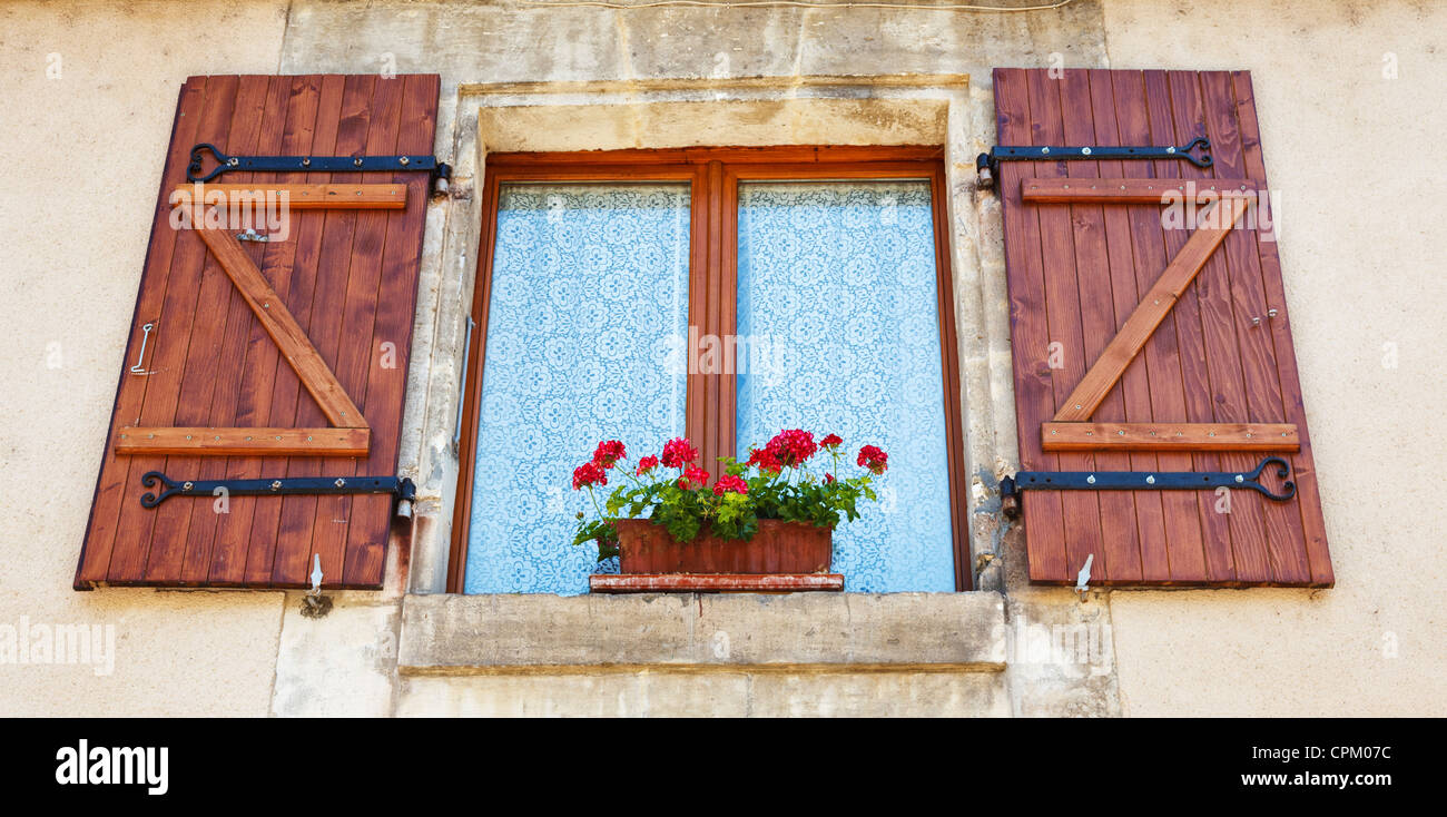 Window with shutters and window box on a house in France - Stock Image