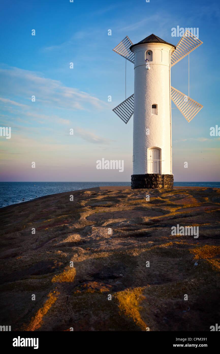 White old lighthouse in Swinoujscie at sunrise, Poland Stock Photo