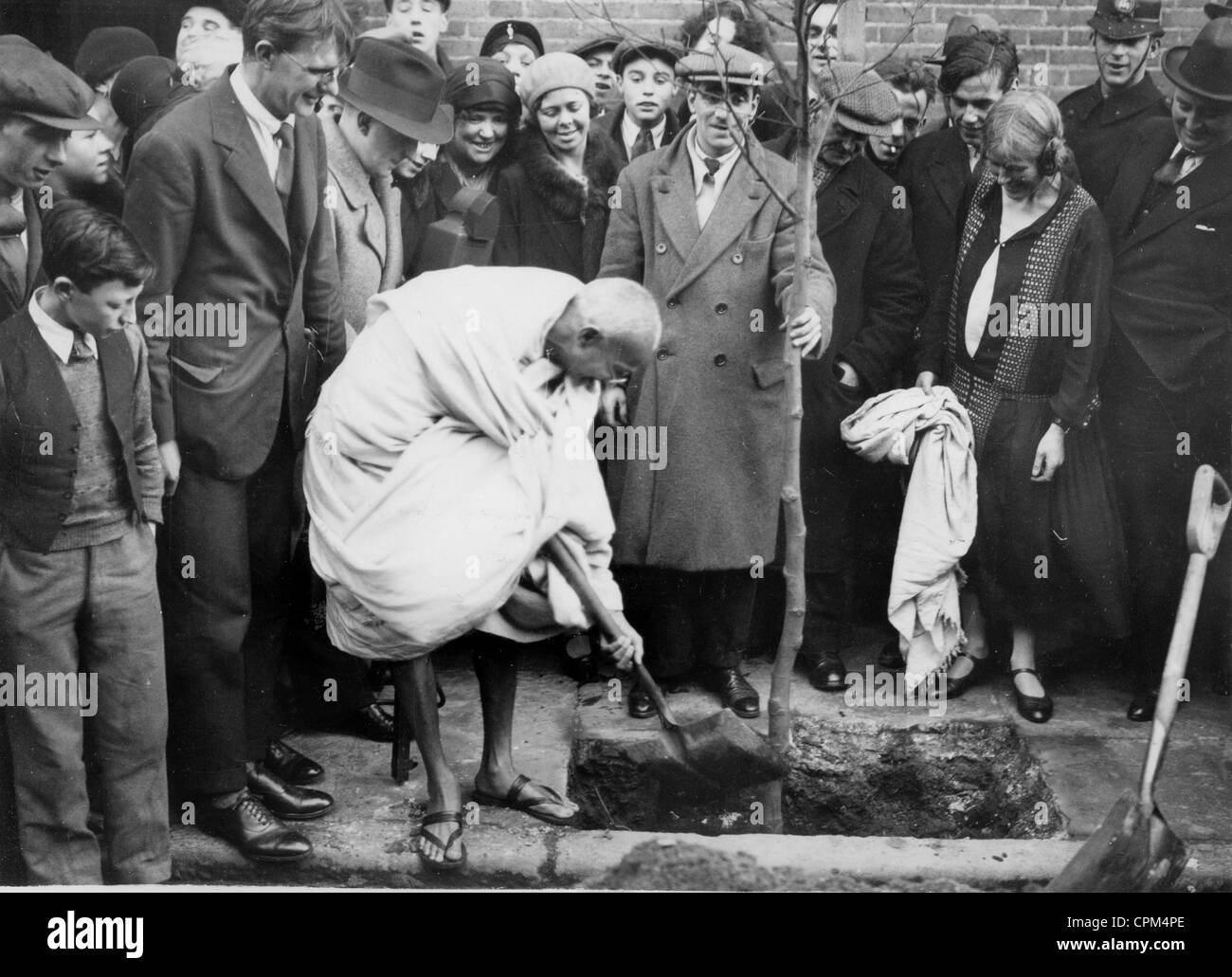 Mahatma Gandhi Planting A Tree Outside Kingsley Hall Bow