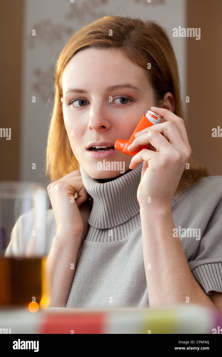 ASTHMA TREATMENT, WOMAN - Stock Image