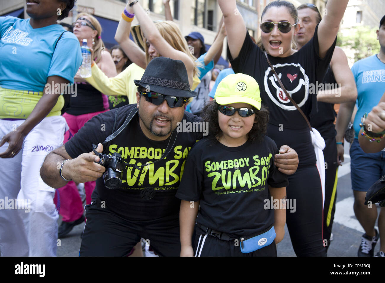 Dance Parade in NYC along Broadway. Memb ers of ZUMBA® Fitness, the latin-inspired dance-fitness program that - Stock Image