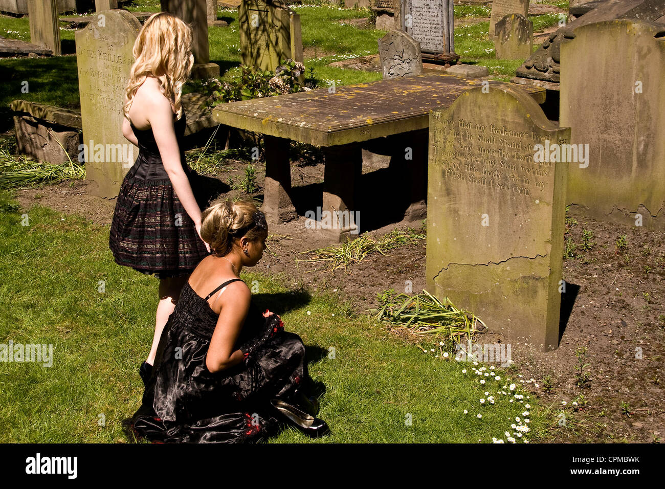 Two glamorous Gothic girls beside old gravestones at the Howff  Cemetery during a photo-shoot in Dundee,UK Stock Photo
