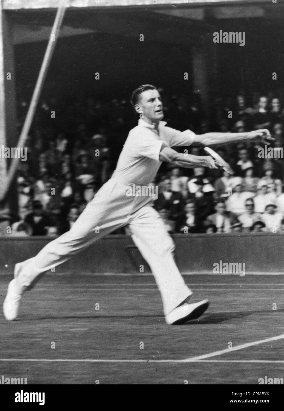 Fred Perry plays a tennis match in Wimbledon, 1931 - Stock Image