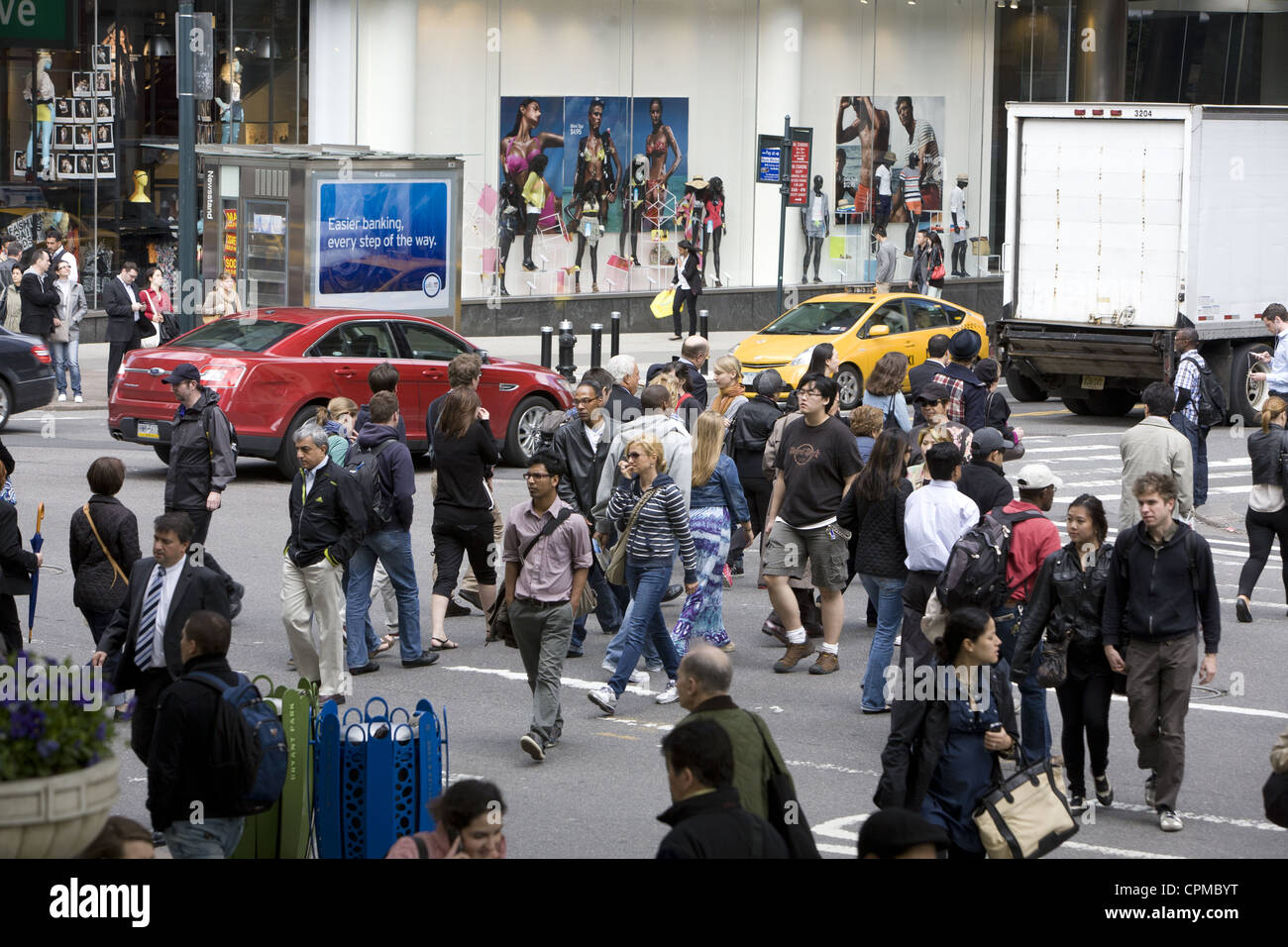 The always busy corner of 42nd Street and 5th Avenue in New York City. - Stock Image